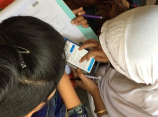 Individuals hold mobile health device