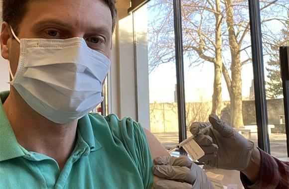 CHRHS Director, Dr. Adam Levine, recieving his COVID-19 vaccine