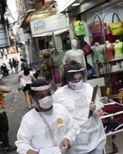 Brazilian medical officials in street