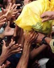 Hands reaching out for relief materials