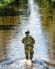 Military member walks in lake
