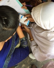 Individuals holding mobile health tool