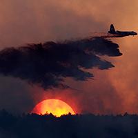 Plane over wildfire