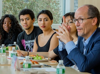 DNC Chair Tom Perez at the Watson Institute, speaking with students