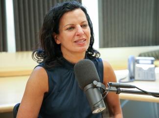 Juliette Kayyem speaking into a microphone