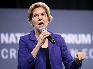 Elizabeth Warren speaks into a microphone