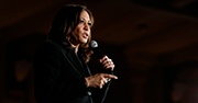 Kamala Harris speaking into a microphone