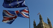 The European Union flag and the British national flag are flown outside the Palace of Westminster in London