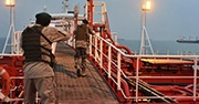 Soldiers of Iran's Revolutionary Guard inspect seized tanker in the Strait of Hormuz