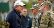George Bush shaking the hand of a soldier