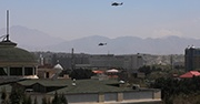 Two helicopters fly over Kabul