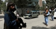 Taliban militants walk in the streets with weapons