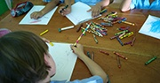 Young children coloring with crayons