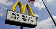 "A McDonald's sign that says ""Now Hiring Day Shifts"""