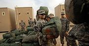 Soldiers handle baggage