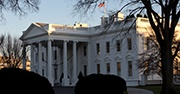 A side profile of the White House on a winter day