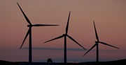 Wind energy farm with a sunset in the background