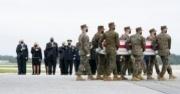 U.S. troops carrying the casket of a fallen soldier