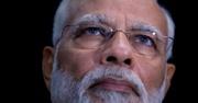 Narendra Damodardas Modi of India - A tan man with light eyes, glasses and white hair