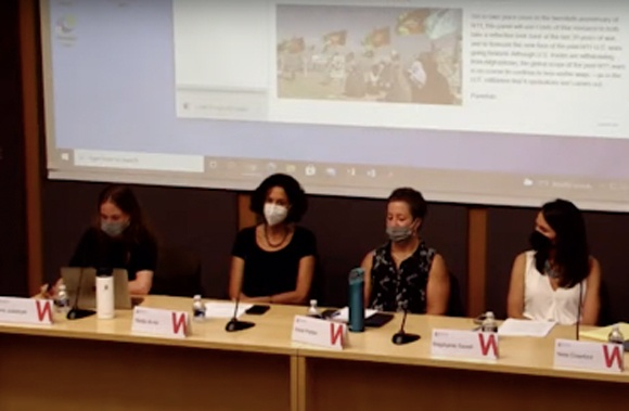 Costs of War event panel with masks on