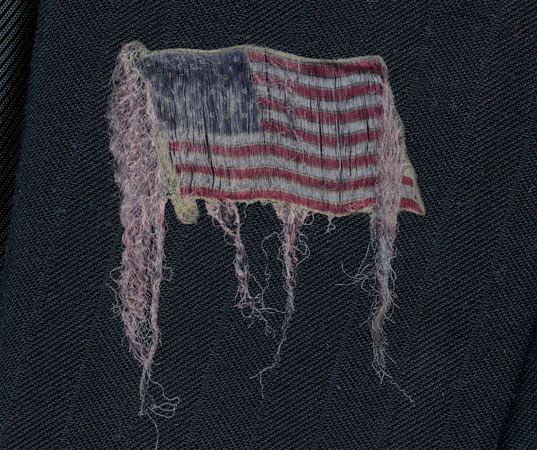 Unraveling: Suit with Lapel Pin - Detail, Flag