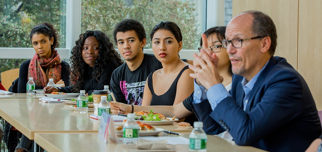 Tom Perez speaking with Brown University students
