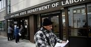 Man stands in front of New York Department of Labor building