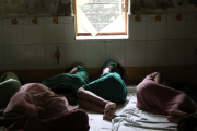 women sleeping on the floor of a mental health facility