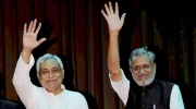Bihar CM Nitish Kumar and Deputy CM Sushil Kumar Modi wave at gathering after their swearing-in ceremony