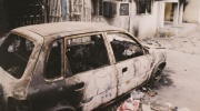 Burned car in the wreckage from the riots