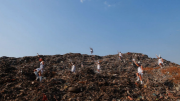 dancers wearing white on a landfill