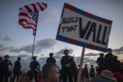 Picketers lined up at the boarder holding signs in favor of building the wall along the boarder of Mexico