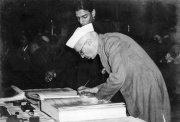 Jawaharlal Nehru, the first Prime Minister of India signing the Constitution of India in 1950
