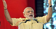 Modi speaking at a podium