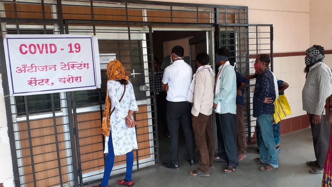 People waiting in line for Covid-19 testing in India