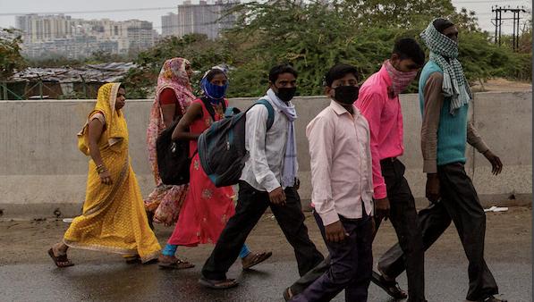 group of migrant workers walking during lockdown