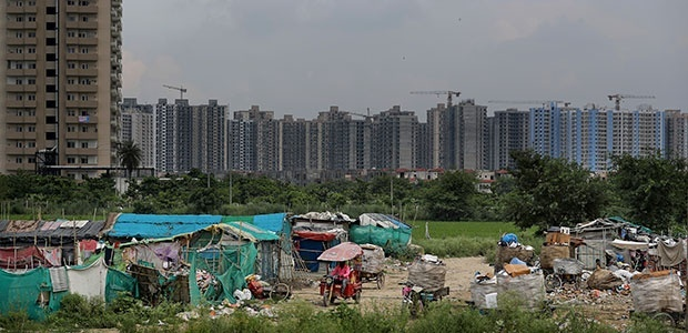 Image of urban high rise behind migrant quarters in South Asia