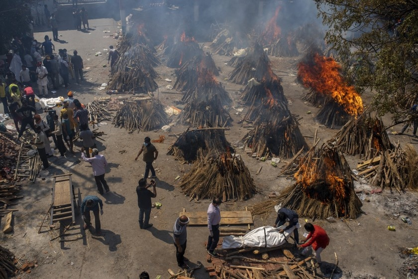 Funeral pyres of victims of COVID-19 burn at a lot that has been converted into a mass crematorium in New Delhi on April 24.